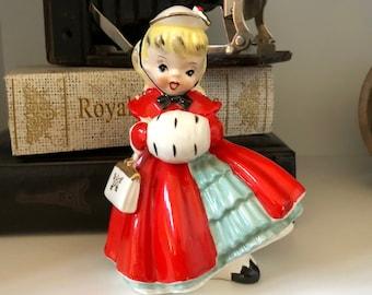 Napco Christmas Girl/National Potteries/Ceramic Christmas Figurine Girl/Winter Coat/Hand Glove Warmer