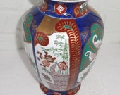 Listing 93 is the Colorful detailed hand painted Gold Imari Vase