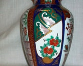 Listing 093 is the Colorful detailed hand painted Gold Imari Vase