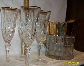 Listing 204 is a Vintage Lead Crystal gold rimmed glasses and beverage pitcher
