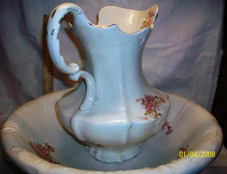 Listing 233 is the Revere Pottery White Floral Pitcher And Basin