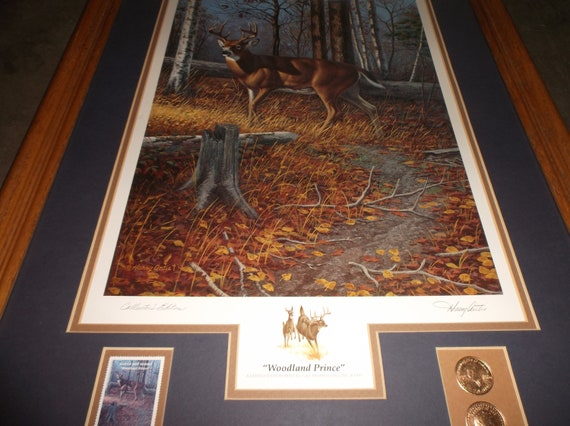 Listing 547 is the Woodland Prince signed by artist with stamps and gold leaf coins and COA