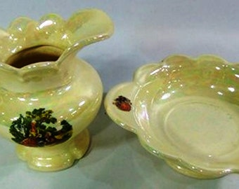 Listing 101 is the irredescent with old world themed pitcher and basin set