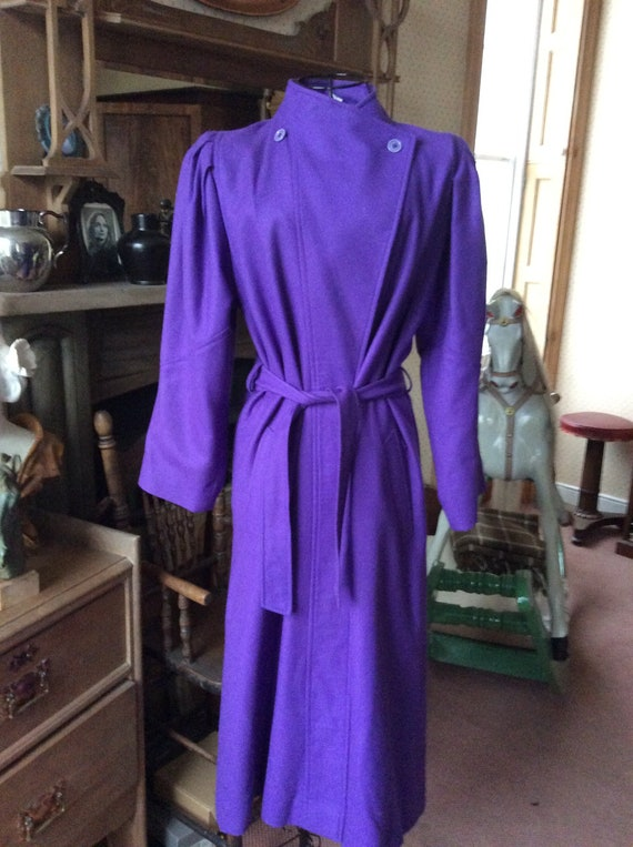 80s purple trench coat, puffed shoulders, cinched