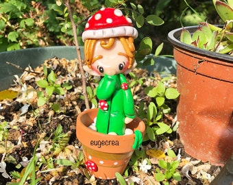 Miniature jar with an Elf in polymer clay