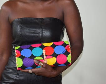 Clutch purse, leather wrapped cloth