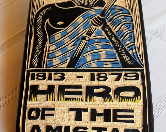 Hand carved plaques commemorating, African history.