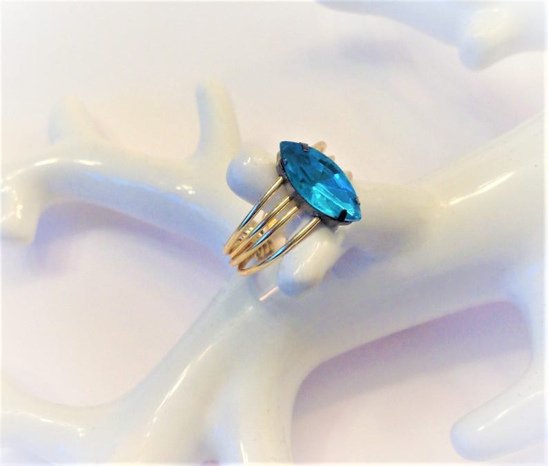 Marquise Cut Teal Blue Ring with Spiral Gold Band