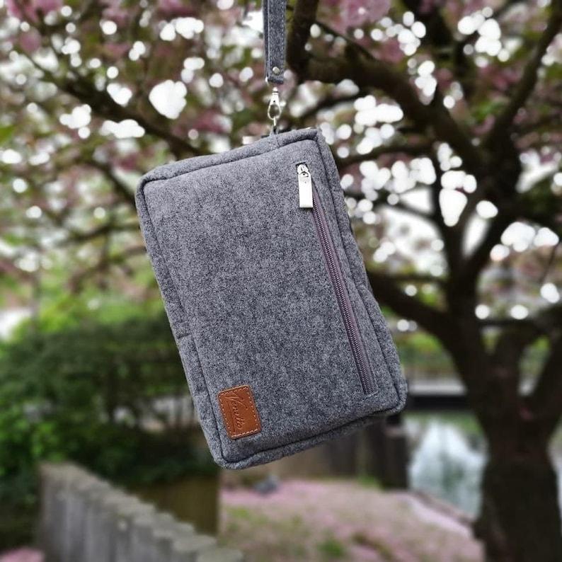 d68bc0478cf58 Handgelenk-Tasche Vertikal 10.6 Herren Brieftasche