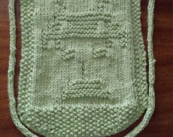 Hand knitted bib with a space invader design
