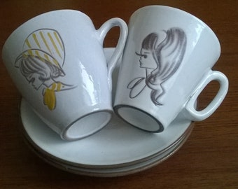 Fifties 2 ceramic cups and saucers with girls ' heads.