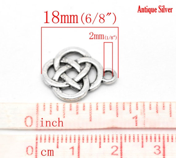 4 Celtic knot charms silver tone R156