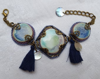 Bracelet blue and purple beading, ceramics, prints, mother of Pearl and tassel