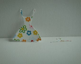 Cut paper design ornate with its little dress hanger for creation