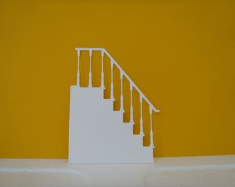 Cutting white stairs for scrapbooking or card making.