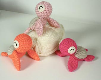 Three little turtles in shades of pink and coral
