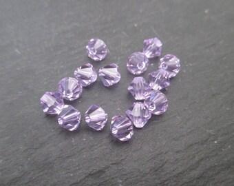 Bicone Crystal Swarovski 6 mm: 4 clear purple beads