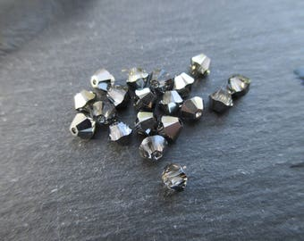 Crystal Swarovski bicone 4 mm: 10 beads Crystal Silver Night.