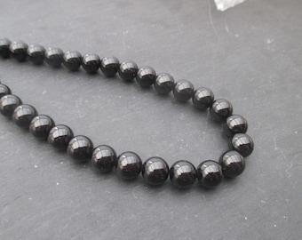 Black tourmaline: 3 round beads 12 mm
