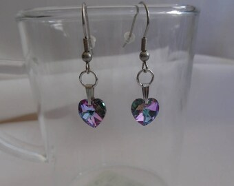 Stud Earrings, purple swarovski crystal hearts with multiple reflections on stainless steel.