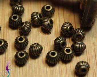 50 beads intermediate pumpkin antiqued bronze