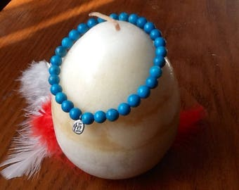 Bracelet turquoise bead and Chinese symbol 1tour