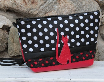 Le Chat-Marré red and black polka dot shoulder clutch