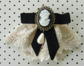 Cameo brooch and lace