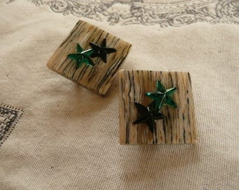 Earrings with clip on beige and black streaked background with black and green stars 2.7x2.7cm