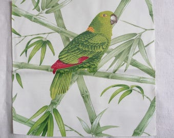 Image sewing Parrot green and red on white background and branches of bamboo
