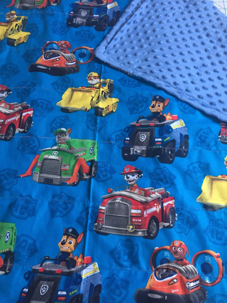 Nick Jr Paw patrol!! Shown with blue minky backing!!30X35 and 35X40 and  40X60  Color options toddler size available