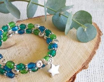 Bracelet d'allaitement, au biberon ou au sein, perles camaieu bleu vert, avec breloque en métal argenté au choix (etoile)
