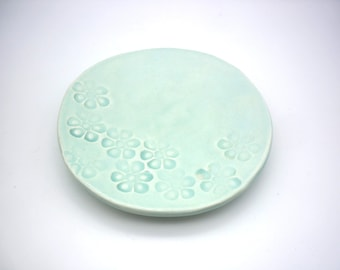 light turquoise blue cup, jewel rest, handmade pottery, artisanal faience