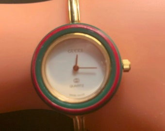 77dddd83578 Vintage Gold Gucci Bangle Watch