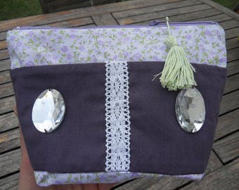Purple makeup bag with outside pockets