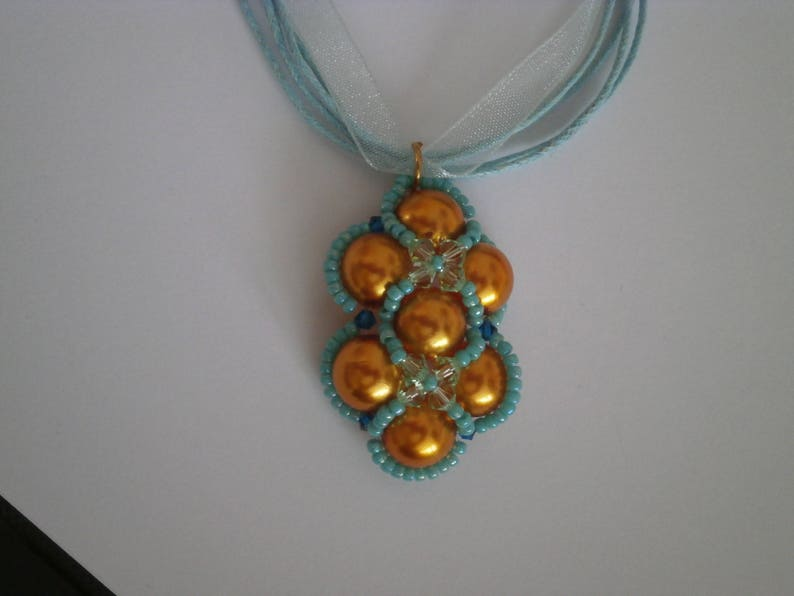 Adornment necklace beaded bracelet and earrings.
