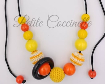 Babywearing and nursing necklace orange, yellow and black ring with wood (max 80 cm)