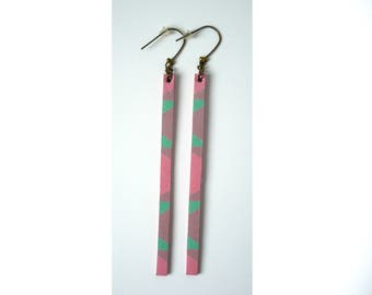 Graphic and long earrings leather