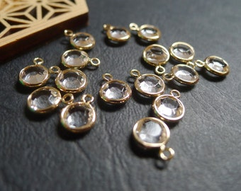 2 golden round sequin charms and 7x10mm pink crystal