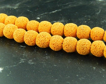 Ochre yellow lava 10mmou 12mm, set of 10 beads