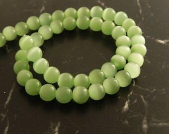Pistachio green cat eye beads 8mm, set of 10