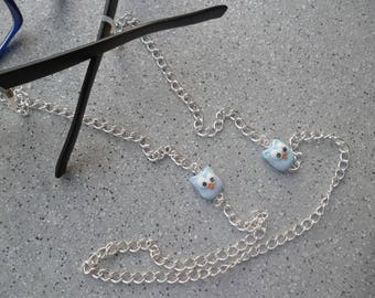 Necklace close to glasses and its pretty cool Fimo charms