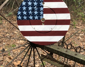 American flag, cable spool, wooden spool
