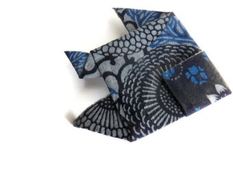 Blue on a small Origami fish brooch silver