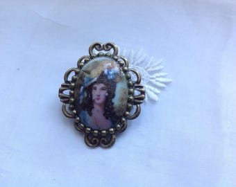 Old cabochon mounted as a brooch, 31x21mm