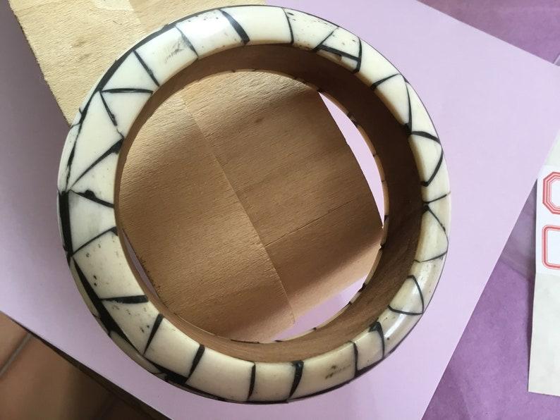 Vintage bracelet wood bone inlaid on stand