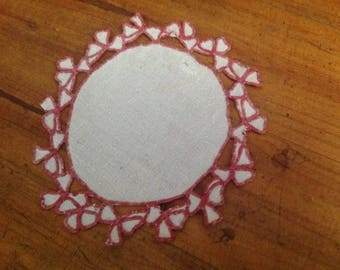 Embroidery in red thread, damask, doily