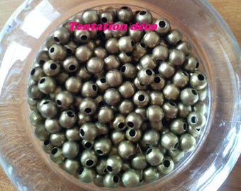 Set of 100 round beads - bronze metal 4 mm T27