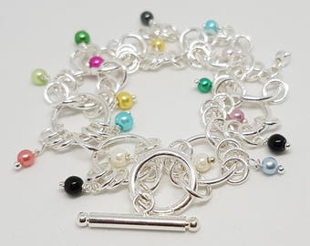 Silver silver bracelet 925 sterling silver interlocking rings and multicolored glass beads