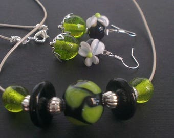 Set in black and lime green - Arabesque trademark flower and swirl